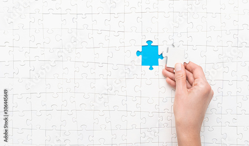Photo Business concept of white jigsaw puzzle.