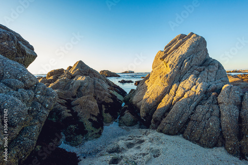 Photo Stands Mountaineering Rocky ocean beach at sunset
