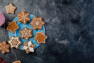Various decorated gingerbread cookies on a plate