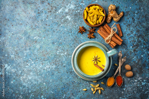 Healthy drink of golden turmeric milk with spices Canvas Print