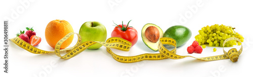 Vegetables and fruits for weight loss with a measuring tape on a white background Canvas