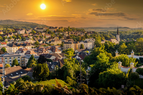 Fototapety, obrazy: View of the buildings and roofs of the picturesque town of Melk on a sunset, Lower Austria, Wachau Valley.