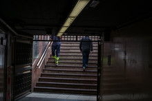 People Going Down And Up Some Subway Stairs
