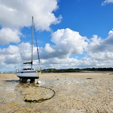 Yacht During Ocean Low Tide In...