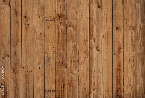 Dark old vertical wood panels with nice patterns and knotholes #306518802