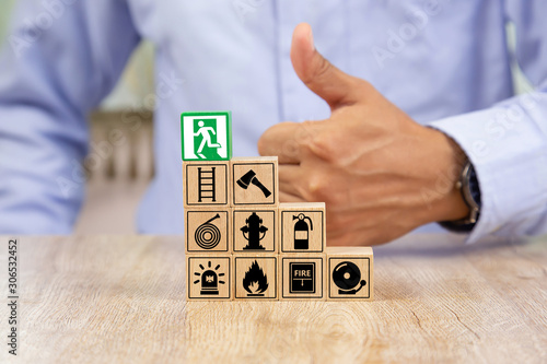 Canvas-taulu Wooded blocks Stacking with fire escape icon for safety concept.