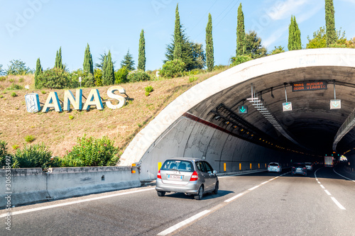 Rome, Italy - August 24, 2018: Sunny summer day and highway road street with ANAS sign and tunnel on modern autostrade
