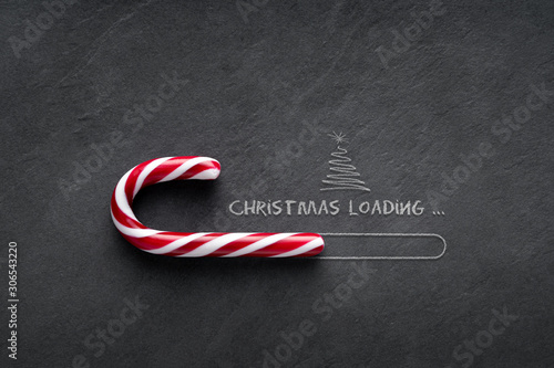 Christmas loading Concept - Candy cane on blackboard with christmas tree - 306543220