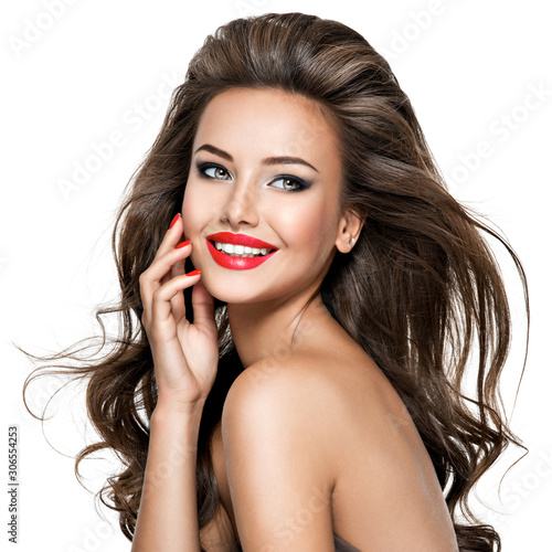 Fototapeta Portrait of  beautiful smiling woman with long brown hair. obraz na płótnie