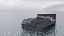 The Bed Floats On The Surface Of A Calm Sea Or Ocean In Cloudy Weather. Outdoor Bedroom In The Open Air. Conceptual Creative Illustration With Copy Space. Imagination In A Dream. 3D Rendering.
