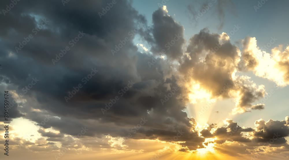 Fototapeta Dramatic sky with shining sun at sunset