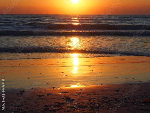 Beautiful Sarasota Sunset with Light Reflected in Gulf Waves