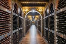Wine Bottles Stacked Up In Underground Wine Cellar