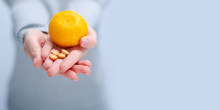 Woman Holding Tangerine And Vi...