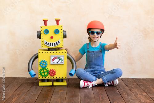 Fotografie, Obraz  Happy child with toy robot