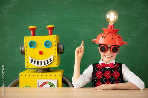 Fototapeta  Happy child with toy robot in school