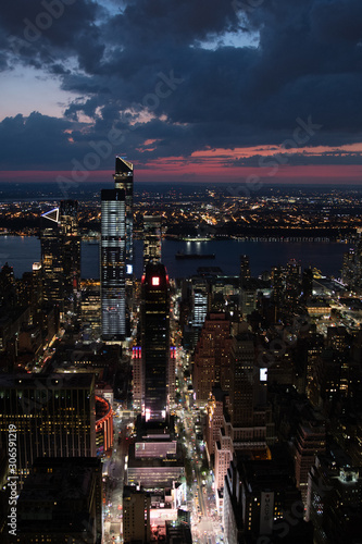 Night view over New York with cloudy sky