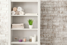 Shelf Unit With Towels And Cos...