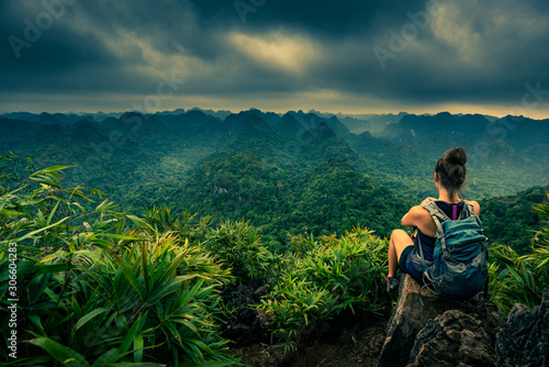 Fototapeta Cat Ba National Park Top of the Hill Young Woman enjoys beautiful view from the Ngu Lam peak in Kim Giao forest, obraz