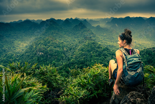Leinwand Poster  Cat Ba National Park Top of the Hill Young Woman enjoys beautiful view from the