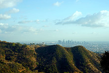 Griffith Observatory Perched High In The Santamonica Mountains Overlooking A Smoggy Los Angeles City