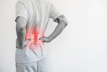Office Syndrome, Backache And Lower Back Pain Concept. A Man Touching His Lower Back At Pain Point