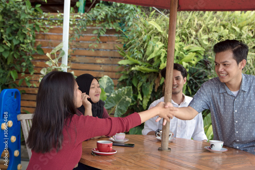 Happy multiracial asian young people hang out outdoors together give high five g фототапет