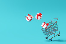 Shopping Cart With Gift Box On Blue Background. Christmas Sale Concept. 3d Rendering