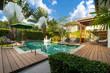 Leinwandbild Motiv Swimming pool in tropical garden pool villa feature floating balloon