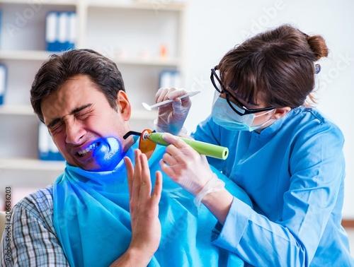 Patient afraid of dentist during doctor visit Wallpaper Mural