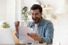 Excited Man Reading Postal Mail Letter Overjoyed By Good News