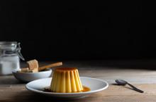 Homemade Creme Caramel Desert On A Dark Background