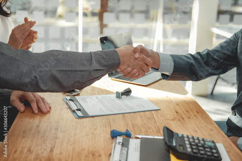 couple customer shaking hands with insurance mortgage broker lawyer realtor Wallpaper Mural