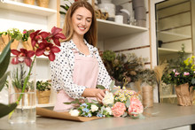 Florist Making Bouquet With Fr...