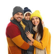 Happy Family In Warm Clothes On White Background. Winter Vacation