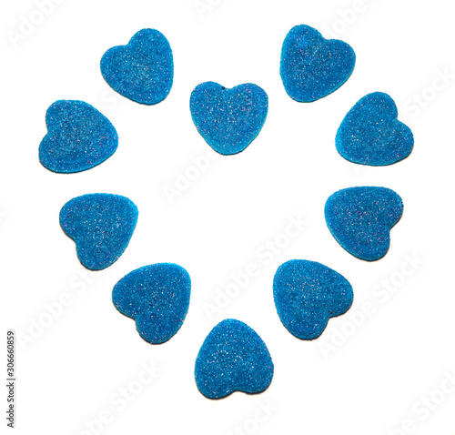 Bright blue chewing marmalade sprinkled with crystal sugar in the shape of a heart isolated on a white background Wallpaper Mural
