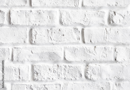 Close-up of vintage white brick wall indoor .