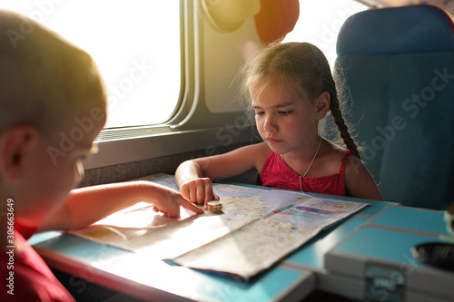 Little boy with his sister discussing their economy vacation during travelling b Canvas Print