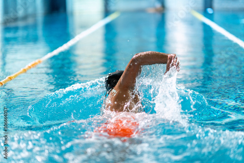 professional swimmer doing exercise in indoor swimming pool Canvas Print