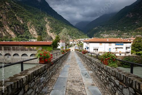 Hone/Bard old bridge over Dora Baltea river, Aosta Valley, Italy Canvas Print
