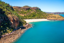 Tourists From A Luxury Expedition Cruise Ship  Explore A Remote Beach On Naturalist Island In The Kimberley Before A Sightseeing Flight Over Prince Frederick Harbour.