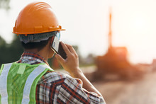 Engineer  Holding Smartphone At Construction Site