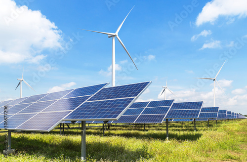 Photo solar cells with wind turbines generating electricity in hybrid power plant systems station on blue sky background alternative renewable energy from nature  Ecology concept