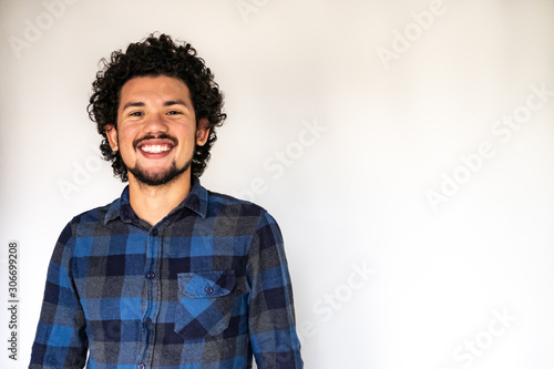Latin American man smiling, neutral background Canvas Print