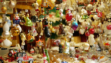 Christmas Market Stall Or Stand With Tree Decorated Ornaments Products Star, Toys, Balls, Garlands, Various, Fish, Ornaments, Cars, And Animals Are Hanged Pine Needles. Decoration Hanging Traditional