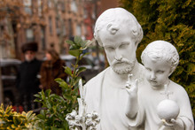 A St Joseph With Jesus Child Statue In A Jewish Neighborhood At Brooklyn, New York