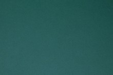 Dark Green Colored Paper Texture Background.