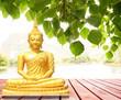 Leinwanddruck Bild The statue of the Buddha sitting under the Bodhi tree.