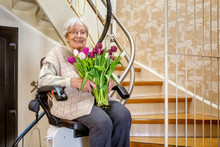 Elderly Woman In The Staircase...