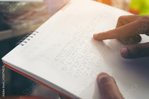 Close-up of fingers reading braille, Hand of a blind person reading some braille text of a braille book Fototapete
